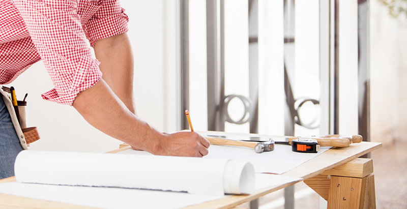 General contractor working on plans for a new home remodel