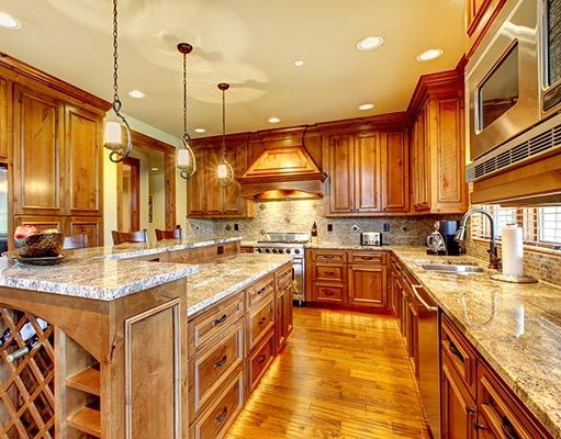Warm-kitchen-remodeled-by-professional-contractor-in-natural-wood